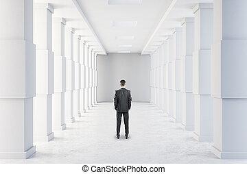 Businessman in modern corridor