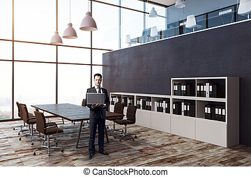 Businessman in modern meeting room