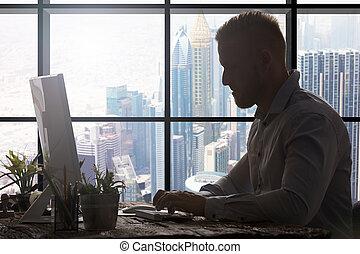 Businessman In Modern Office