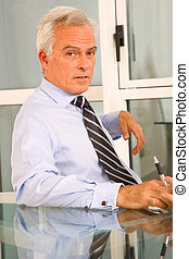businessman in office at the desk