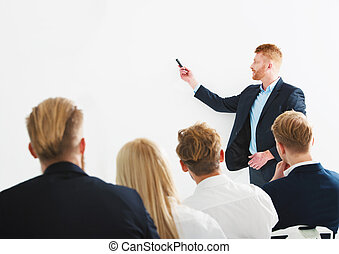 Businessman in office explain something at a training meeting