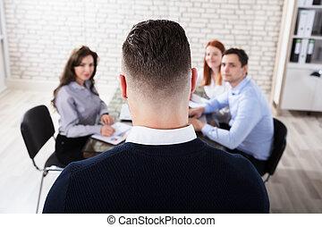 Businessman In Office Meeting