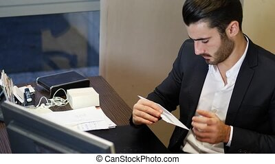 Businessman in office receiving correspondence