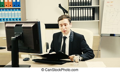 Businessman in office typing at the computer