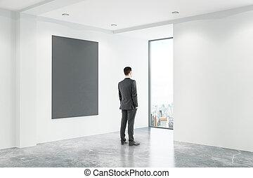 Businessman in office with blackboard