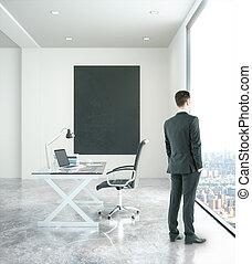 Businessman in office with chalkboard