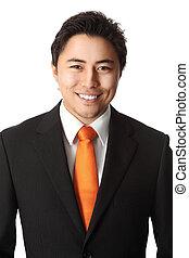 Businessman in orange tie close up