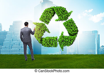 Businessman in recycling ecological concept