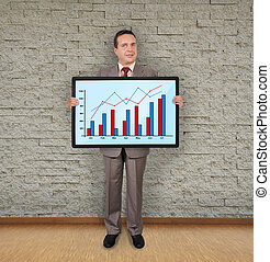 plasma with graph - businessman in room holding plasma with ...