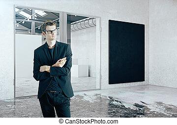 Businessman in room with blackboard