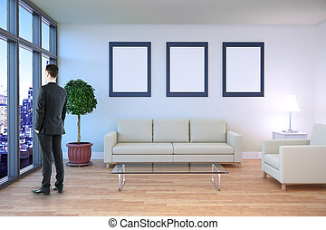 Businessman in room with frames