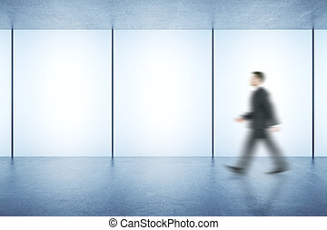 Businessman in room with posters