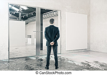 Businessman in room with whiteboard
