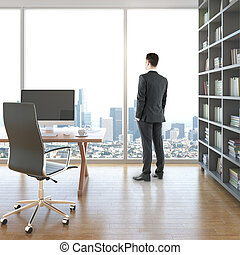 Businessman in room with workplace