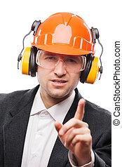 Businessman in safety hardhat helmet gesturing exclamation point