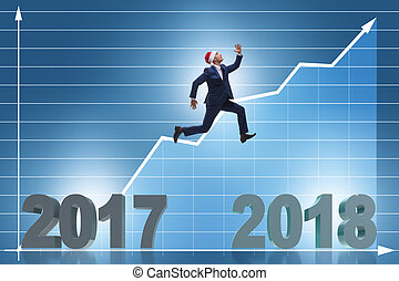 Businessman in santa hat jumping from 2017 to 2018