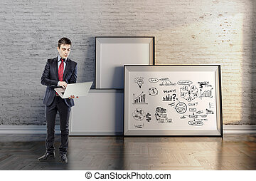 businessman in suit and business plan on grunge wall