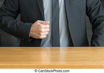 Businessman in suit and wood table