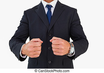 Businessman in suit clenching fists