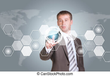 Businessman in suit finger presses virtual button. Transparent hexagons, world map as backdrop