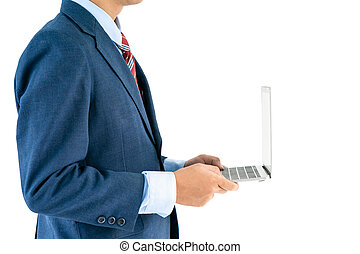 Businessman in suit holding a laptop