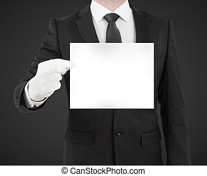 businessman in suit holding blank poster