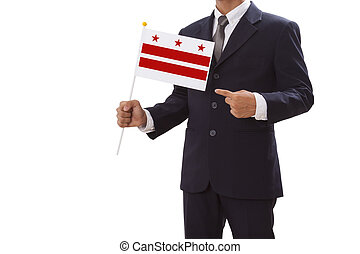 Businessman in suit holding Flag