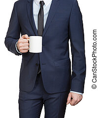 Businessman in suit holding mug in hand