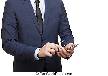 Businessman in suit holding smartphone in hand