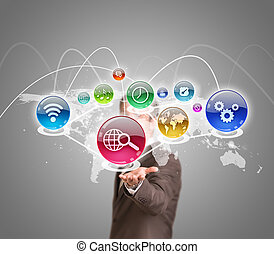 Businessman in suit holding world map with app icons. ...