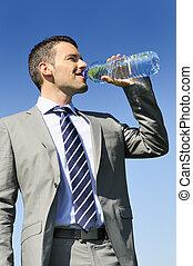 fresh water - businessman in suit is drinking fresh water in...