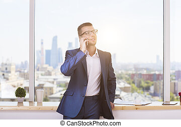 Businessman in suit on phone