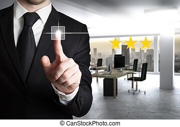 businessman in suit pushing button one star rating