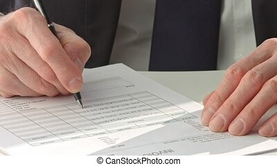 Businessman in suit signing a document