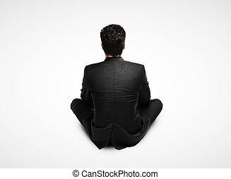 businessman in suit sitting
