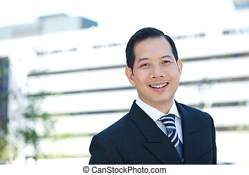 Businessman in suit smiling