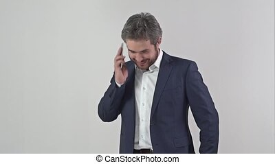 Businessman in suit talking on a mobile phone