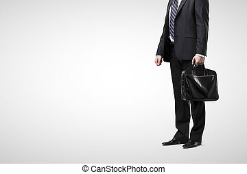 businessman in suit with black briefcase