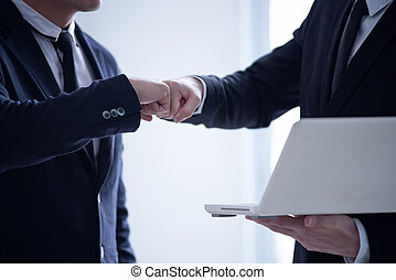 Businessman in suits making fist bump at the office, Power of cooperation and business success team concept