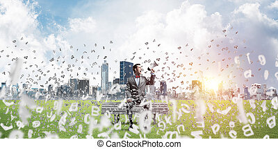 Businessman in summer park on bench announcing something in loudspeaker and symbols fly around