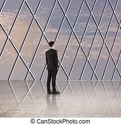 businessman in sunlight hall
