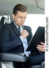 Businessman In The Car