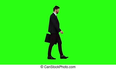 Businessman in the hands of a diplomat, he waves to people. Green screen. Slow motion