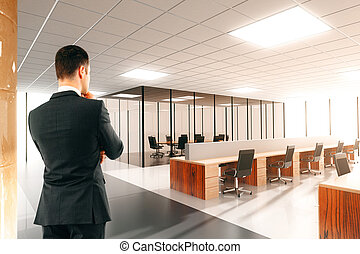 Businessman in the light open space office
