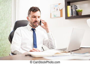 Businessman in the middle of a phone call