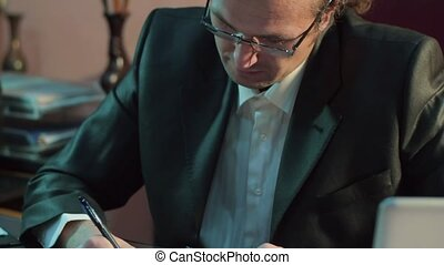 Businessman in the office to sign the documents. Office employee black blazer