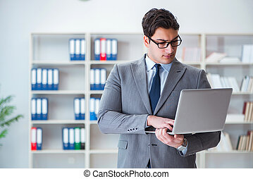 Businessman in the office working with laptop