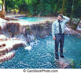 Businessman in the waterfall