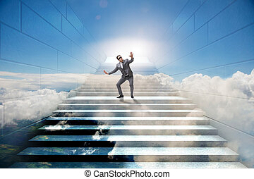 Businessman in uncertainty concept on career ladder