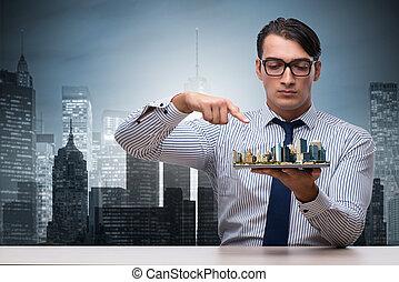 Businessman in urban planning concept